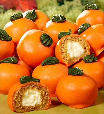 "Sweeten up your Thanksgiving dessert with these delightful and beautiful pumpkin mini cakes, similar to petit fours. Consisting of a dozen delicately spiced cakes with nutmeg and ginger and filled with a luscious cream cheese center, these pumpkin cakes are perfect for your own Thanksgiving or to give the host or hostess to say ""thanks!"":"