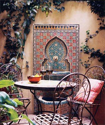 Moorish mosaic wall fountain and table.