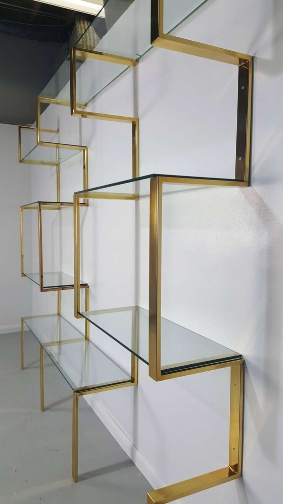 View this item and discover similar shelves for sale at 1stdibs - Architectural brass etagere shelving unit after Milo Baughman, 1970s. Wall mount system that can be adjusted to various widths to suite your space. Newly