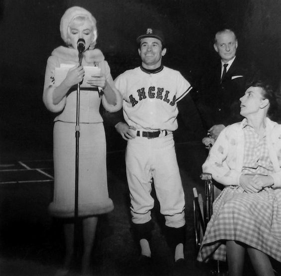 Marilyn giving a speech at her last public appearance at a baseball game at Dodgers Stadium to benefit Muscular Dystrophy, 1 June 1962.
