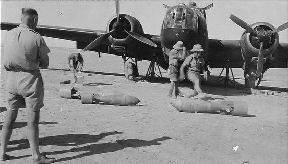 Unloading a damaged Wellington Bomber in North Africa.