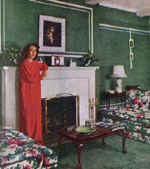 The Hostess By The Fire Place In Her First Nyc Apartment In The East River District 1949 S Nyc Apartment House Colors Joan Crawford