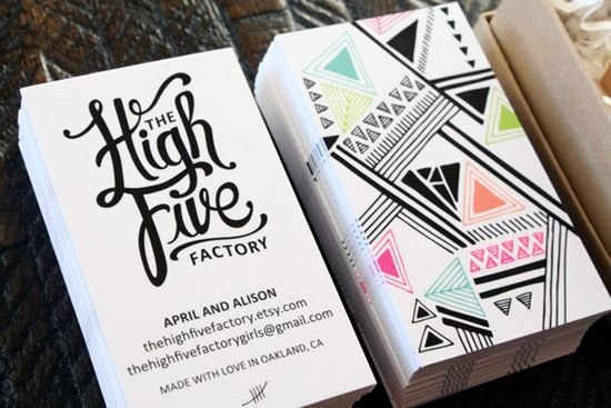 Black and white business cards with patterned colorful back