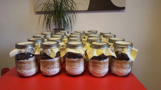 Homemade DIY Chewy chocolate chip cookies with marshmellow filling mason jars. This was part of the gifts for the guests at a baby shower I organized. Yellow theme.
