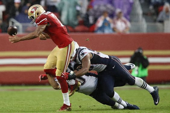 Colin Kaepernick Photos Photos - Colin Kaepernick #7 of the San Francisco 49ers fumbles the ball against the New England Patriots during their NFL game at Levi's Stadium on November 20, 2016 in Santa Clara, California. - New England Patriots v San Francisco 49ers