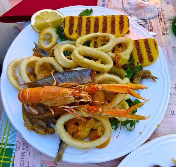 fried seafood plate in Venice Italy http://placesiveeaten.blogspot.it/2014/08/can-you-even-get-bad-meal-in-italy.html