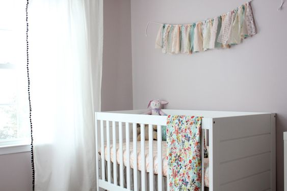 The fabric garland adds a sweet touch to this #babygirl #nursery!