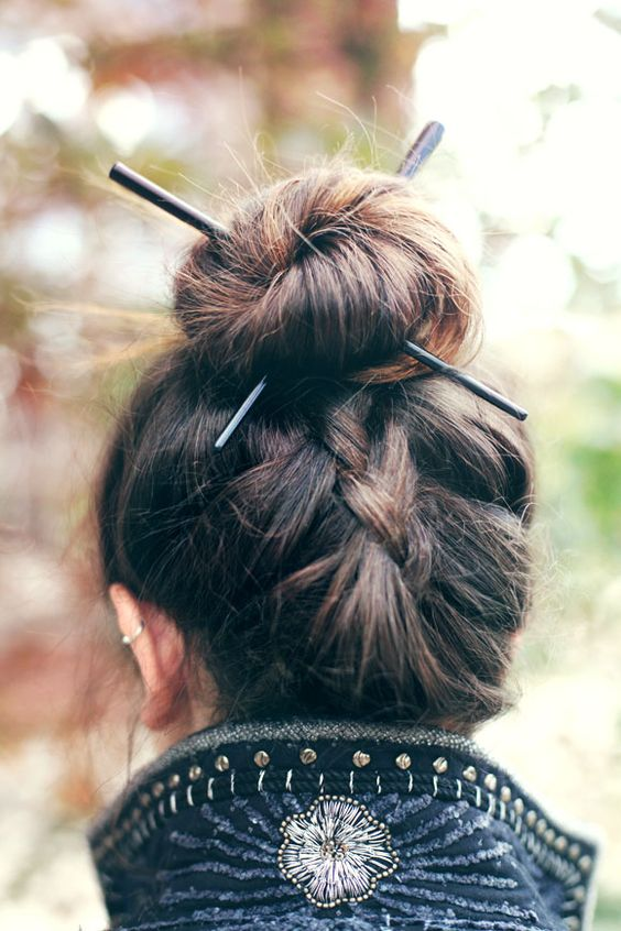 Chopstick Hairstyles. I could give or take the chopsticks, but I love the hidden braid below the bun!