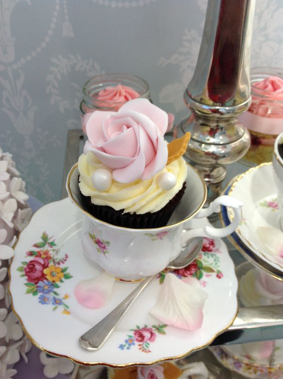 Rose cupcake in vintage teacup. Wedding cakes London, Hertfordshire, Essex and Kent.