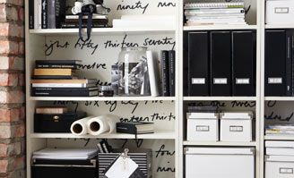 Love this bookshelf- I love the organization to it- yet it looks busy and full. I love the writing on the back of it.