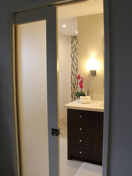 the frosted pocket door creates privacy and adds to the
