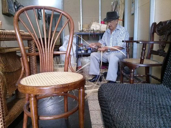 Colombian woodworker. This Thonet chair is one of my favourites because of the simplicity and the steam bended wood. The Colombian woodworking is making a seat with basketry.