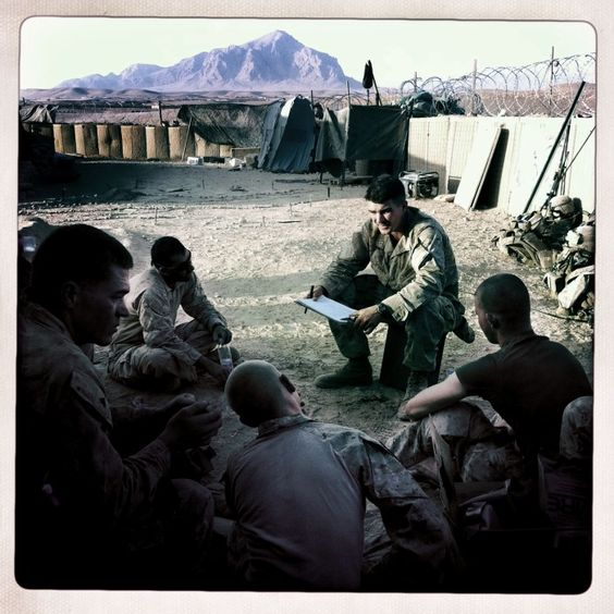 Alpha Company CO Captain O'Brian debriefs his Marines at OP Kunjak on Oct. 15, 2010.