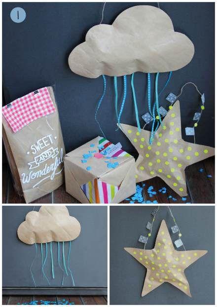 """Nuage  découpé dans du papier craft rempli de bonbons en guise de """" piniata"""", à suspendre. idée plutot rigolote!"""