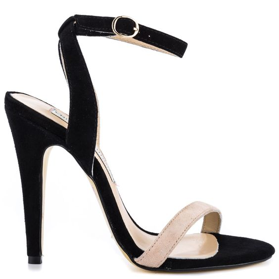 Lead the way in the Lotteria by Kristin Cavallari.  This stylish sandal features a black and beige suede covering the upper and vamp.  An adjustable ankle strap and 4 1/2 inch stiletto heel perfects this pretty number.