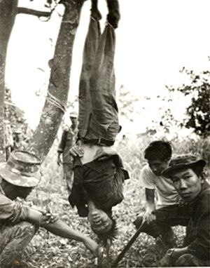 This was Sean Flynn's most famous war photo. A U.S. Special Forces team strung up and tortured a Viet Cong who had shot a little girl—1966.: