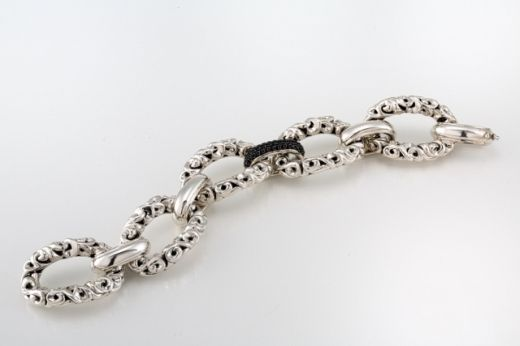 Ivy & Black Sapphire Bracelet: This sterling silver and 14k white gold bracelet features 43 sapphires that weigh a total of 1.57 carats! $2,200.00.