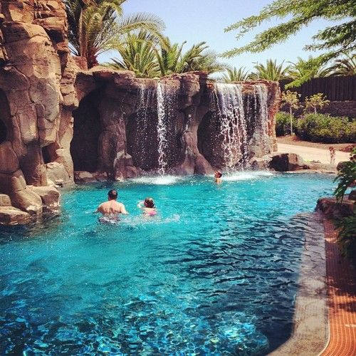 Pool waterfall pools and waterfalls on pinterest for Luxury pools with waterfalls