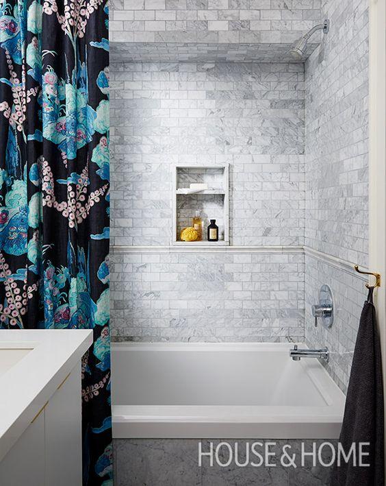 A tiled chair rail gives the tub walls a trad flavor.  Photographer: Michael Graydon  Designer: Sarah Hartill