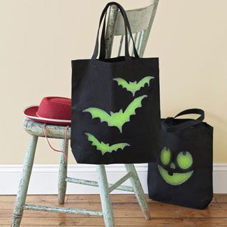 """""""Glow Wild - Here's a bright idea: trick-or-treat bags that illuminate at night."""" Done with glow-in-the-dark fabric paint. Click through for instructions and templates."""