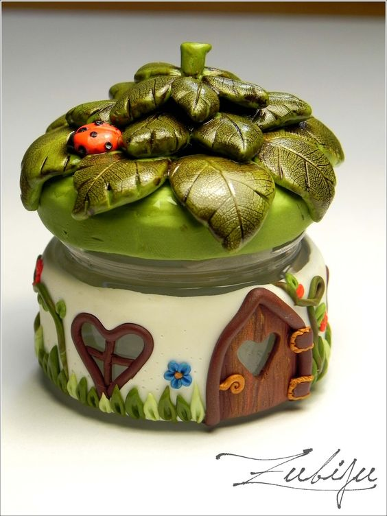Fairy jar: polymer clay on glass...could use some of those tiny jars from the lab