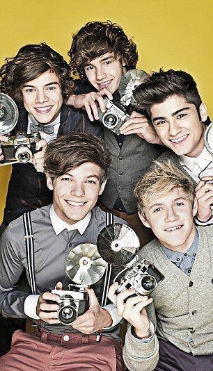 One Direction...this picture must have been taken a while ago because Liam has curly hair and Niall has crooked teeth