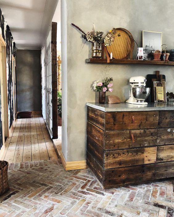 6 Brick Kitchen Floor Ideas We Re Currently Obsessing Over Hunker Brick Floor Kitchen Brick Kitchen Dark Wood Kitchens
