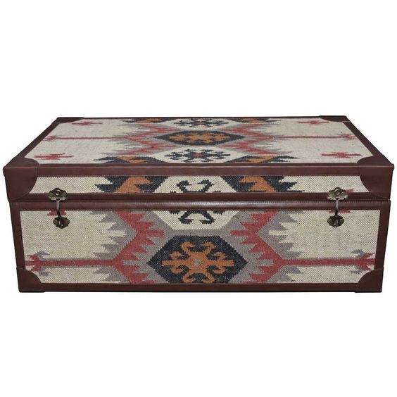 Double use furniture is just the best! This coffee table is also a storage trunk (and probably the most stylish one you've ever seen) and it gives off major wanderlust vibes!