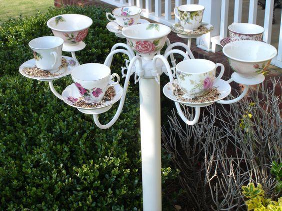 Tea cup bird feeder.:
