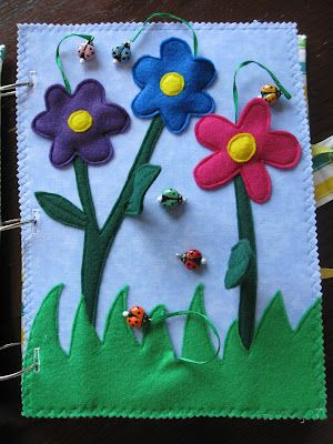 Flower quiet book page with little lady bugs on strings.