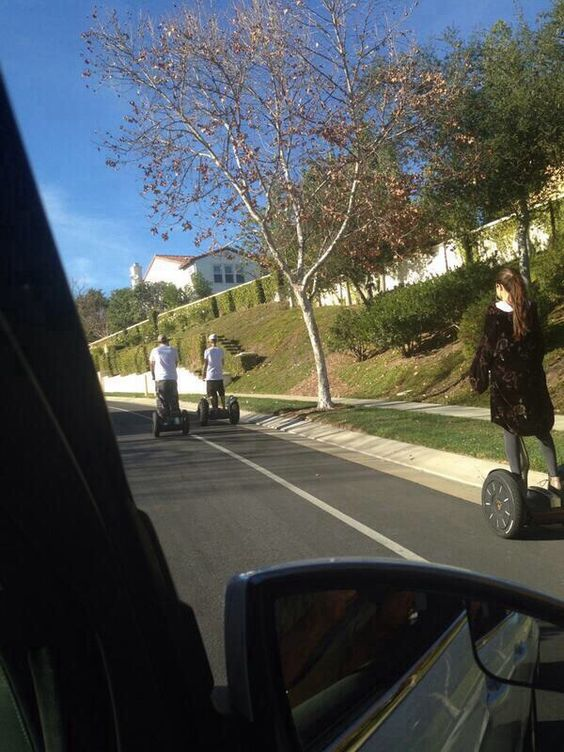 @nicksanitsky: Bieber and Selena segwaying in the Oaks. She was so nice, so he yelled at us