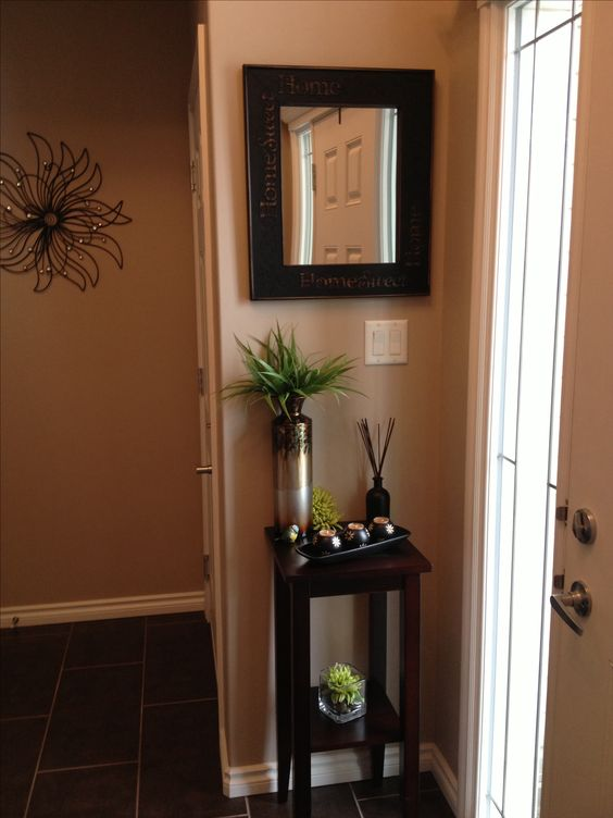 Entryway decor for small space. Like the idea of a small table, not this decor.  Like the organization of this.