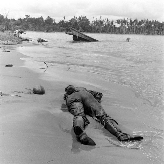 Not published in LIFE. Alternate view of beach seen in famous George Strock photo, Buna, New Guinea Campaign, WWII.