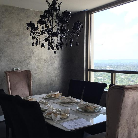 . . .dramatic black chandelier for the win! Finally up, wallpaper installed, now we just need the right artwork & accessories. Obsessed with this modern glam dining room. #interiorsXashlina