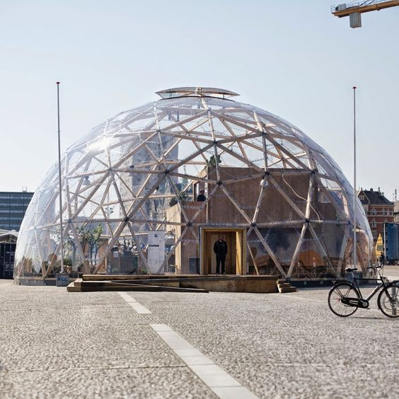 This is the idea for our next house! A house inside an outer shell (dome) for protection from the elements. Most efficient is it the house has some what of a pyramid shape to maximize size inside the dome: