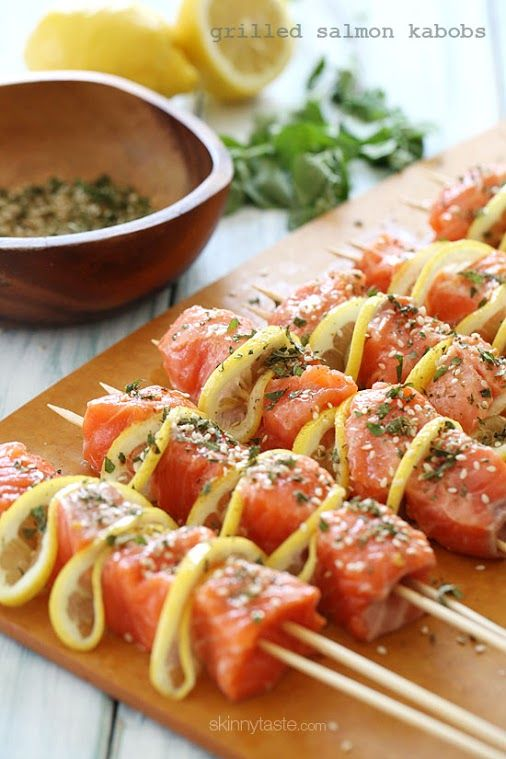 Grilled Salmon Kabobs: Salmon cubed, and skewered with lemon slices and herbs.