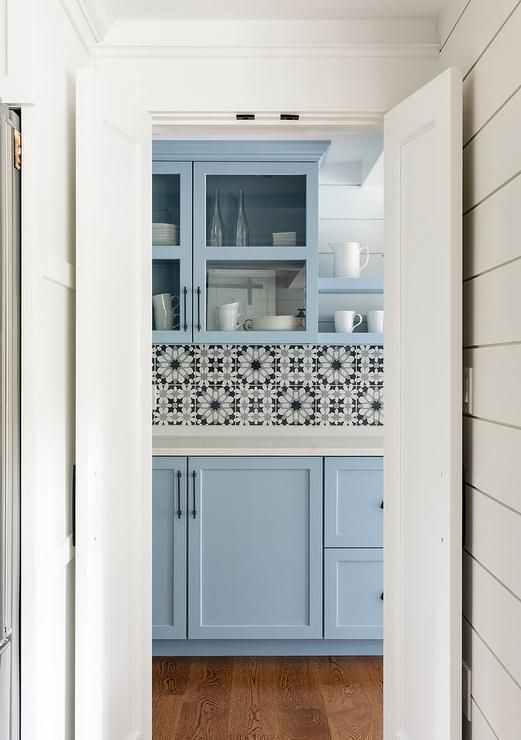 Charming White Blue And Black Mosaic Tiles Finish A Pantry Backsplash Accented With Blue Shaker Cab Shaker Style Cabinetry White Marble Countertops Home Decor