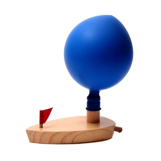 Fun and Physics... Wooden boat powered by a balloon. Float the boat on water, then blow up a balloon, stretch it over the funnel and then release it.