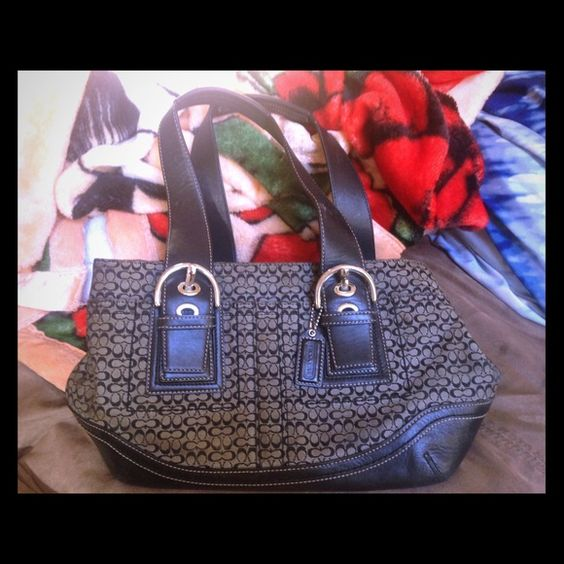 Coach purse Coach purse. It was well loved, so it's not perfect like new but a quick little clean it would look new maybe a small scuff or two. I'd keep it but it's not my style. I'd rather it go to someone who'd love it :) Coach Bags Shoulder Bags