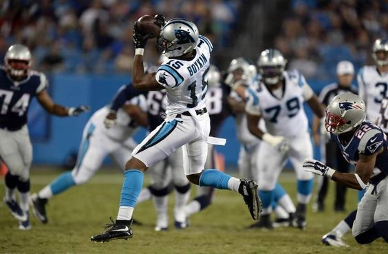Carolina Panthers' Jarrett Boykin (15) makes a reception past New England Patriots defenders during the second half in their preseason game at Bank of America Stadium on Friday, August 28, 2015. New England won, 17-16.