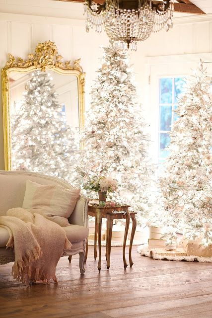French Country Christmas decor in a beautiful family room with gilded mirror