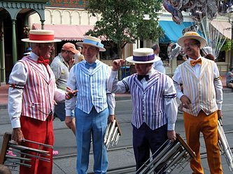 Barbershop Music: This was a place for men to gather and socialize where they could sing in a cappella four part harmonies between 1900 and 1919. African american folk songs and hymns were featured with this type of music. Sleeve garters were worn by these performers as well as boater hats, striped vests, and very showy bright colors.