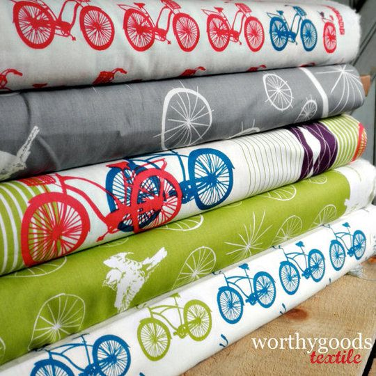 Fun bike print fabric! Hm... not sure I'd wear anything made of it myself but I bet many women (and girls) would!: