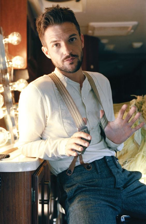 Brandon Flowers. The only guy I think looks just as attractive with the moustache. And I hate moustaches.