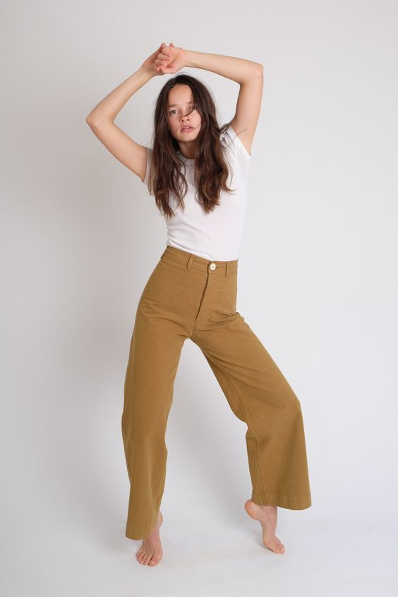 100% FINE COTTON CANVAS IN THE PERFECT KHAKI/ TOBACCO COLOR. REGARDING FIT. THESE PANTS RUN SLIM IN THE HIPS. IF YOU HAVE A LARGER CABOOSE, AND ARE BETWEEN SIZES, WE SUGGEST GOING UP IN SIZE. A TAILOR CAN EASILY TAKE IN THE WAIST. YOU WANT THE TUSH TO FIT... NOT TOO TIGHT, BUT JUST RIGHT. TO FIND