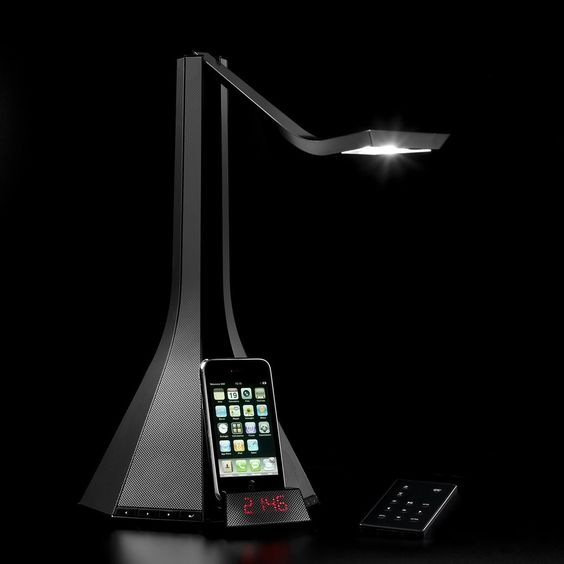 Light fixture with built in radio, clock, 4 interior speakers, and a retractable iPod dock. Also has 2 aux outputs on the back if you want to hook it up to your own speakers. Basically, everything you need on your nightstand in one.