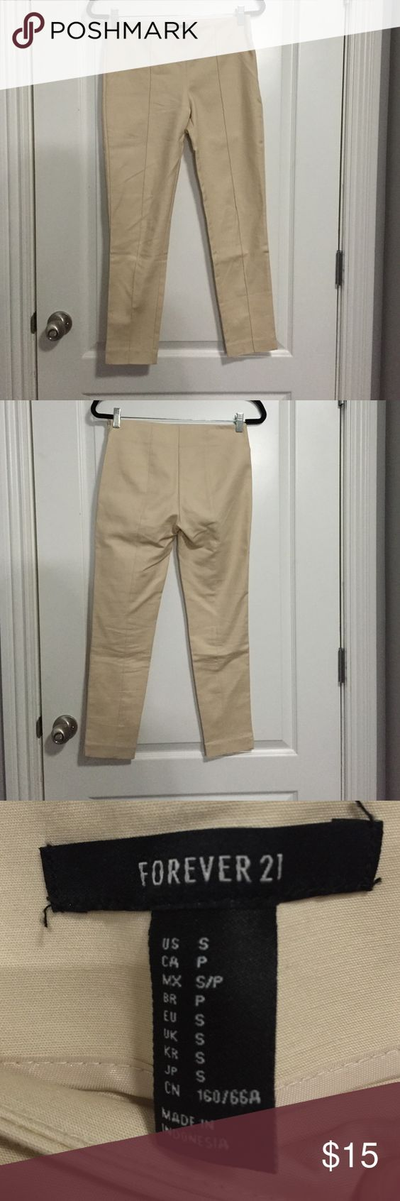 Cream work trousers Perfect work pants. Size small from Forever 21. Never worn. Has side zipper and no pockets. Seams down front and back of legs. Forever 21 Pants Trousers