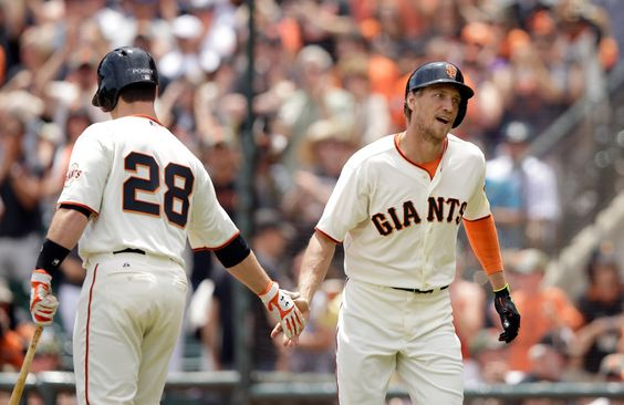 Hunter Pence #8 of the San Francisco Giants is congratulated by Buster Posey #28 after he hit a home run in the first inning of their game against the Colorado Rockies at AT&T Park on June 14, 2014 in San Francisco, California. (June 13, 2014 - Source: Ezra Shaw/Getty Images North America)