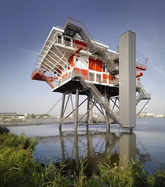 Rem Island, Amsterdam. Formerly a pirate broadcasting home and now a restaurant. The structure pretty much is what I would like to achieve in my Dwelling plus design, stairs exposed, connecting to the landscape.