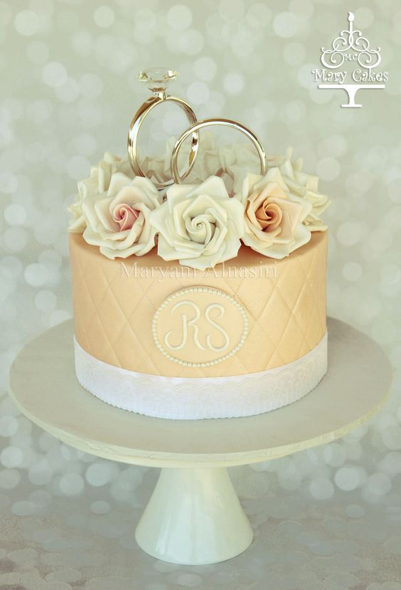 sugar roses engagement cake ,#ring topper  #proposal cakes  By : Mary Cakes